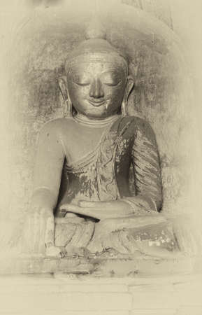 witness: Golden Buddha in Bhumiparsa Mudra position, Calling the Earth To Witness the Truth, Dhammayangyi Temple, Bagan,  Myanmar (Burma)