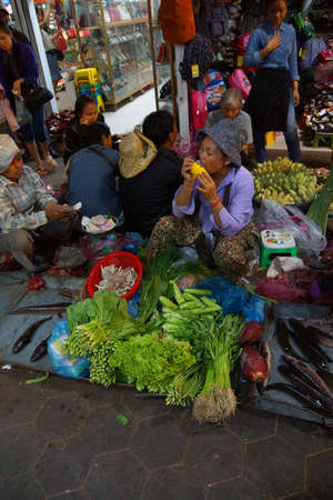 reap: SIEM REAP, CAMBODIA - FEB 16, 2015 - Woman selling vegetables in the market of  Siem Reap,  Cambodia