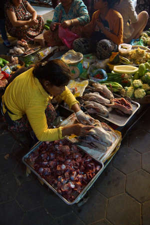 reap: SIEM REAP, CAMBODIA - FEB 16, 2015 - Woman selling chicken in the market of  Siem Reap,  Cambodia