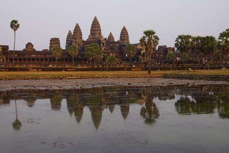 Sunset, central gopura towers and reflecting pool, Angkor Wat, Cambodia