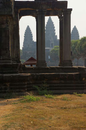 thru: Central gopura towers seen thru western collonade Angkor Wat,  Cambodia