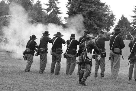 civil war: Union infantry line firing a volley,  Civil War Battle Re-enactment,  Port Gamble, WA Editorial