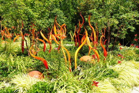 chihuly: SEATTLE - JUL 23, 2015 - Orange blown glass tubes swirl in the Chihuly Garden and Glass Museum,  Seattle, Washington