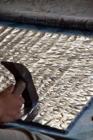 lye: Hammering lead sheets to make silvery lead foil,Kyaukme Myanmar (Burma) Stock Photo