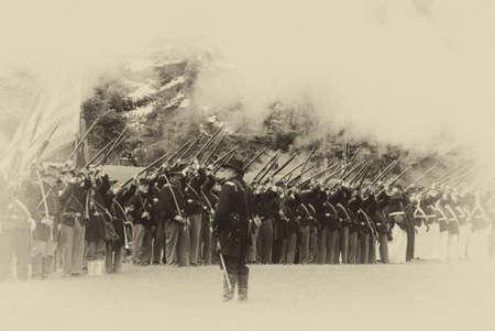 PORT GAMBLE, WA - JUN 20: Civil War reenactors participate in a mock battle. Union infantry line firing a volley. Stock Photo - 43351913