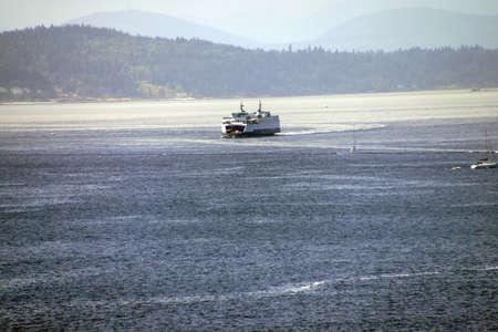puget: Washington State ferry crosses Puget Sound and nears  Seattle, Washington