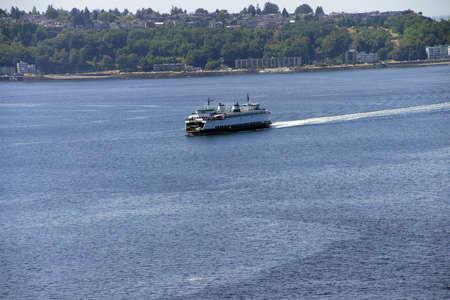 puget sound: Washington State ferry crosses Puget Sound and nears  Seattle, Washington