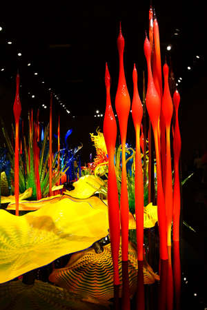 blown: SEATTLE - JUL 23, 2015 - Blown glass in abstract shapes in red and yellow,  Chihuly Garden and Glass Museum,  Seattle, Washington