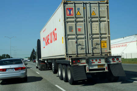 tacoma: TACOMA, WASHINGTON - MAY 8, 2015 - Truck moves with traffic on the freeway  near Tacoma, Washington