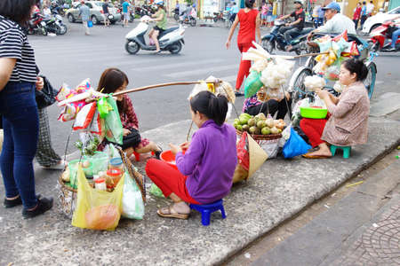 vendor: SAIGON - FEB 4, 2015 - Street vendor sells food in Saigon (Ho Chi Minh City),  Vietnam Editorial