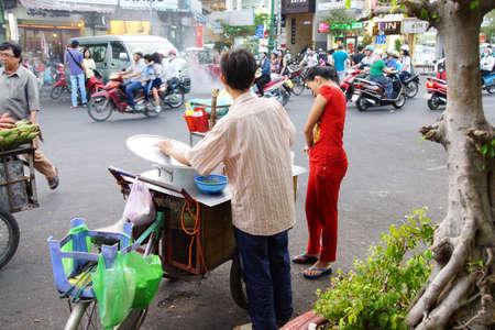 street vendor: SAIGON - FEB 4, 2015 - Street vendor sells food in Saigon (Ho Chi Minh City),  Vietnam Editorial