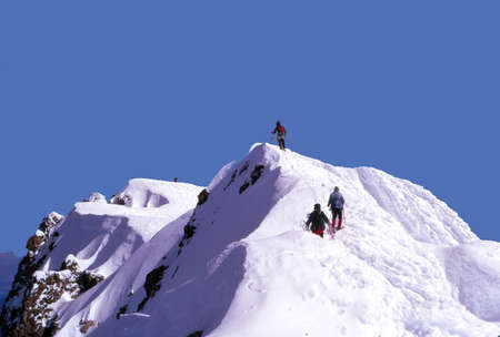 Climbers approaching summit of Mt. Hood, Oregon Imagens
