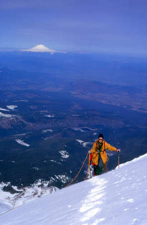 MT HOOD, OREGON - MAR 24, 1973 - Climber on west side route with Mount St Helens in background, Mt. Hood, Oregon
