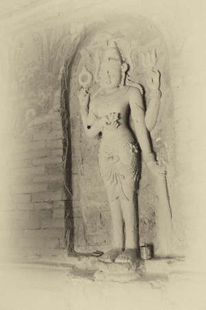 vishnu: Four armed Vishnu carving in Nathlaung Kyaung Temple, Bagan,  Myanmar (Burma)