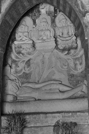 vishnu: Sleeping Vishnu dreaming the creation (Brahma), protection (Vishnu) and destruction (Shiva) of the worldNathlaung Kyaung Temple, Bagan,  Myanmar (Burma)