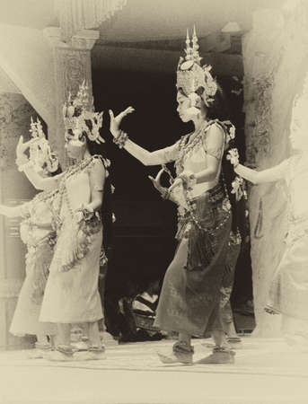 recital: SIEM REAP, CAMBODIA - FEB 14, 2015 - Apsara dancer in red skirt performs at an evening recital,  Siem Reap,  Cambodia Stock Photo