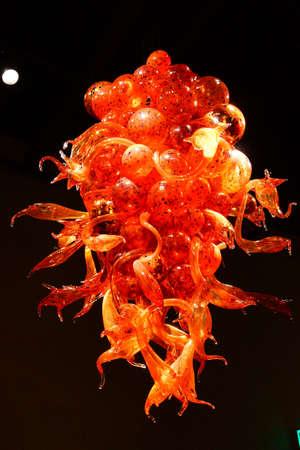 blown: SEATTLE - JUL 23, 2015 - Orange blown glass chandelier in the Chihuly Garden and Glass Museum,  Seattle, Washington