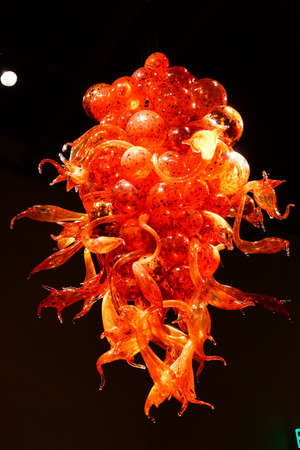 chihuly: SEATTLE - JUL 23, 2015 - Orange blown glass chandelier in the Chihuly Garden and Glass Museum,  Seattle, Washington