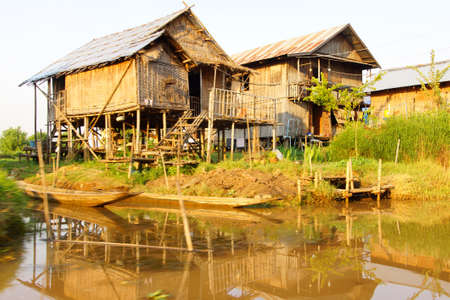 zancos: Traditional Shan house on stilts along a canal on Inle Lake Myanmar (Burma) Editorial