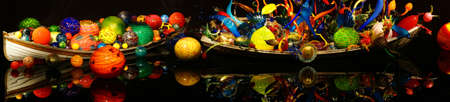 chihuly: SEATTLE - JUL 23, 2015 - Blown glass spheres in boat,  Chihuly Garden and Glass Museum,  Seattle, Washington Editorial