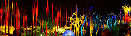 chihuly: SEATTLE - JUL 23, 2015 - Blown glass in abstract shapes in red and yellow,  Chihuly Garden and Glass Museum,  Seattle, Washington