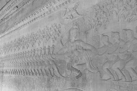 churning: ANGKOR WAT, CAMBODIA - FEB 13, 2015 - Churning of the sea of milk battle of devas and asuras, scene from the Bahgavat Purana Hindu creation myth, Angkor Wat,  Cambodia