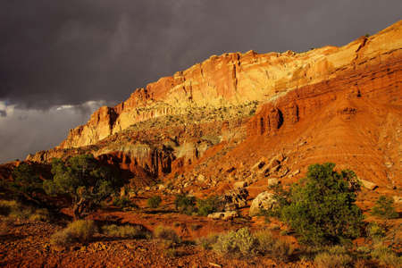 sedimentary: Golden Throne glows with  dramatic backlighting for sedimentary rock of red Navajo sandstone,Capitol Reef National Park, Utah Stock Photo