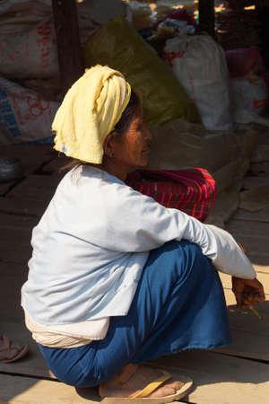 cheroot: INLE LAKE, MYANMAR - MAR 1, 2015 - Elderly Shan woman smokes her cheroot cigar at the weekly ymarket on  Inle Lake,  Myanmar (Burma)