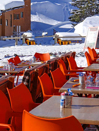 skiers: Bright orange chairs set up for skiers lunch , Portes du Soleil, France Stock Photo