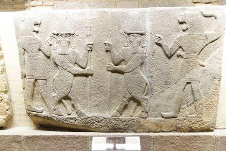 bce: ANKARA, TURKEY - MAY 21, 2014 -  Guardian spirits and lion headed men, from Kargama about 800 BCE,  Ankara, Turkey Editorial