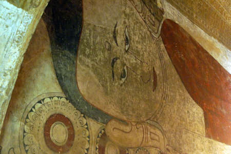 smiling buddha: BAGAN, MYANMAR - FEB 25, 2015 - Ancient fresco painting of Buddha smiling, Htilominlo Temple, Bagan,  Myanmar (Burma)