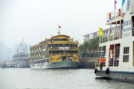 prow: HALONG BAY, VIETNAM - FEB 2, 2015 - Yellow dragon head on prow of boat Halong Bay, Vietnam Editorial