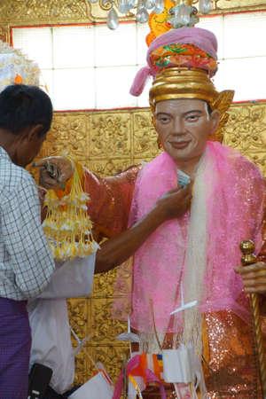 YANGON, MYANMAR - MAR 2, 2015 - Statue of Bo Bo Gyi, nat guardian spirit of the temple,  Botataung Pagoda, Yangon,  Myanmar (Burma)
