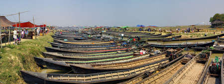 weekly market: INLE LAKE, MYANMAR - MAR 1, 2015 - Empty boats await tourists  at a weekly market on Inle Lake,  Myanmar (Burma) Editorial