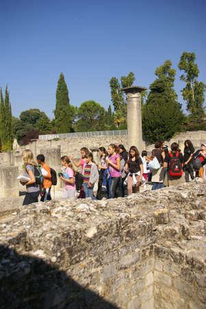 roman pillar: VAISON LA ROMAINE, FRANCE - SEP 23, 2011 - Tourists visit the ruins of Roman villas ofVillasse Roman ruins, Vaison la Romaine, France