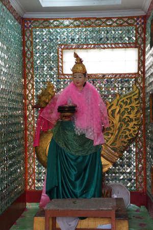 nat: YANGON, MYANMAR - MAR 2, 2015 - Statue of Bo Bo Gyi, nat guardian spirit of the temple,  Botataung Pagoda, Yangon,  Myanmar (Burma)