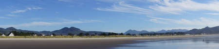 cirrus: Panorama of high cirrus clouds over Seaside, Oregon coast Stock Photo