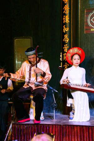 stringed: HOI AN, VIETNAM - FEB 3, 2015 - Musicians play ancient Chinese stringed instruments,  Hoi An, Vietnam