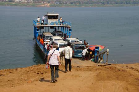 thom: KOMPONG THOM, CAMBODIA - FEB 11, 2015 - Passengers board a Mekong River ferry,  near Kampong Thom,  Cambodia