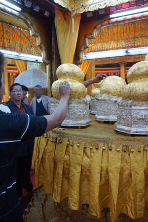daw: INLE LAKE, MYANMAR - MAR 1, 2015 - Buddha statues hidden under thick layers of gold leaf,  Hpaung Daw U Pagoda, Inle Lake,  Myanmar (Burma)