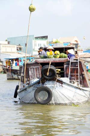 cai rang: CAI RANG, VIETNAM - FEB 7, 2015 - Boat sells large squash  at the Cai Rang floating market,  Vietnam Editorial
