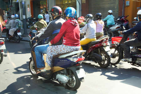 SAIGON - FEB 5, 2015 - Motorbikes compete in heavy traffic of Saigon (Ho Chi Minh City),  Vietnam Editorial