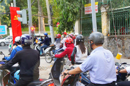 SAIGON - FEB 4, 2015 - Motorbikes compete in heavy traffic of Saigon (Ho Chi Minh City),  Vietnam