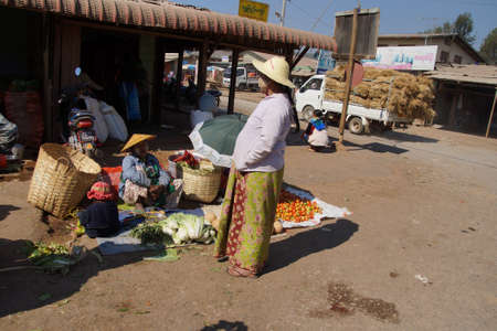 villager: AUNG BAN, BURMA - FEB 28, 2015 - Local Shan women at the weekly market in  Aung Ban,  Myanmar (Burma)