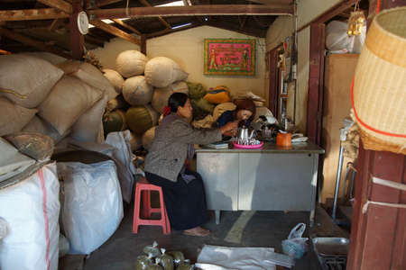 AUNG BAN, BURMA - FEB 28, 2015 - Women prepare tea in a tea warehouse in  Aung Ban,  Myanmar (Burma)