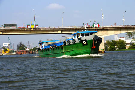 outbound: Large green cargo boat outbound from the floating market, Cai Rang,  Vietnam Stock Photo