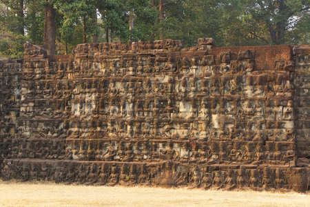 Apsaras and devas decorate the wall of the Elephant Terrace, Angkor Thom,  Cambodia