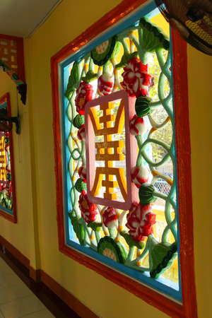 lattice window: MEKONG RIVER, VIETNAM - FEB 7, 2015 - Carved lattice work window of  Cao Dai Temple,  Mekong River delta,  Vietnam Editorial
