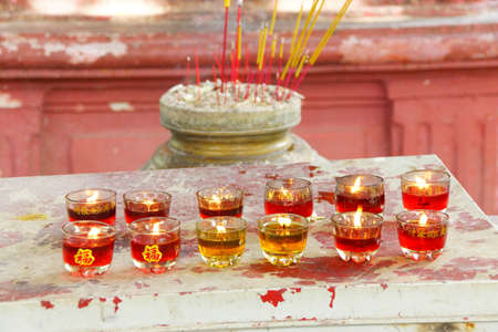Votive candles and incense,  Emperor Jade Pagoda, Chua Phouc Hai pagoda, Saigon (Ho Chi Minh City),  Vietnam