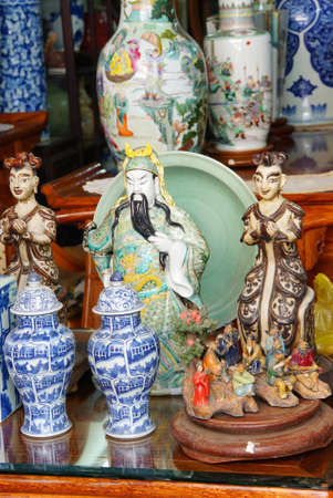 antique asian: Vintage porcelain for sale at the  Antiques market in Saigon (Ho Chi Minh City),  Vietnam